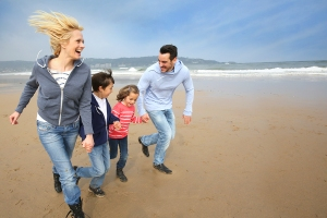 bigstock-Family-running-on-the-beach-44457916