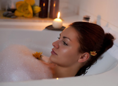 stock-photo-19419623-beautiful-young-woman-relaxing-in-bathtub