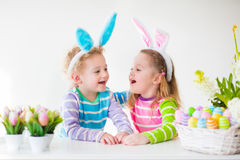 kids-celebrating-easter-home-happy-children-celebrate-boy-girl-wearing-bunny-ears-enjoying-egg-hunt-playing-color-eggs-66288041